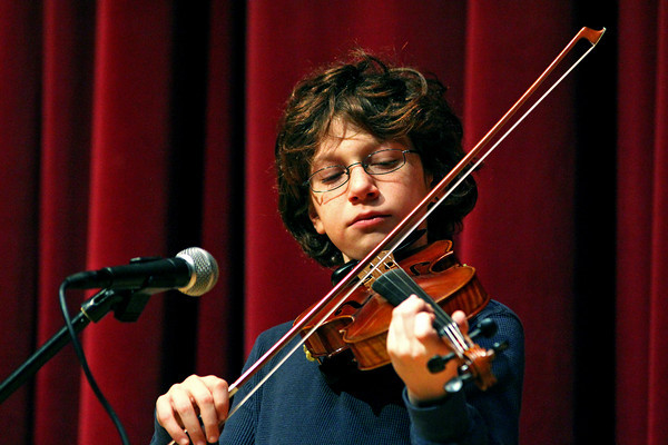 Amesbury: Issac Browne, a fifth grader at Amesbury Middle School, rehearses his violin performance Wednesday afternoon in preperation for the school's upcoming talent show. Photo by Ben Laing/Staff Photo