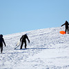 Amesbury: Sledders make the long trek up the hill at Woodsom Farm Thursday afternoon, as Wednesday's nor'easter kept schools closed an extra day. Photo by Ben Laing/Staff Photo