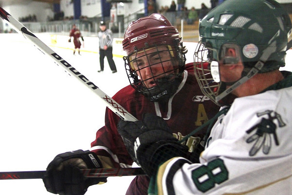 Haverhill: Newburyport's Gaven LaValley (7) checks Pentucket's Garrett Dubina (18) into the glass during Monday night's 3-1 Clipper victory in Haverhill. Photo by Ben Laing/Staff Photo