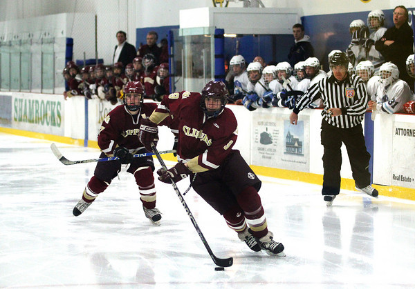 Wilmington: Newburyport's Kris Holmes (9) walks in on the Wilmington goal off the opening face off of the third period. Holmes would bury a shot, bringing the Clippers to within one goal, before they would eventually tie their hosts 2-2. Photo by Ben Laing/Staff Photo