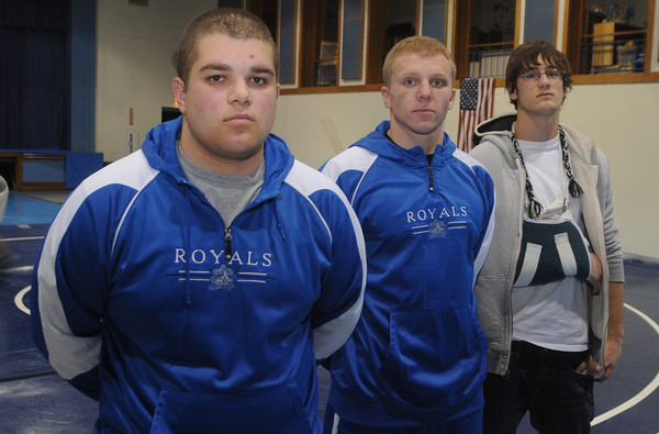 Georgetown:Georgtown wrestler Eric Gesualdi with his fellow captains Shawn Kavanagh and Andrew Galanis.<br />  Jim Vaiknoras/Staff photo