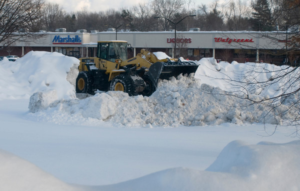 Newburyport: A frontend loader clears snow from the Market Basket Shopping plaza on Story Ave in Newburyport Friday afternoon. Jim Vaiknoras/Staff photo
