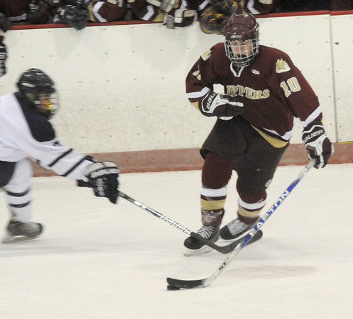 Peabody: Newburyport 's Nathan Hickman makes a move past a Lynnfield  during their game at O'Keefe Rink in peabody Saturday. Jim Vaiknoras/Staff photo