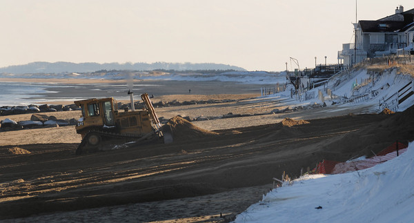 Newbury: A bulldozer moves scraps sand on Plum Island Beach Sunday morning. JIm Vaiknoras/Staff photo