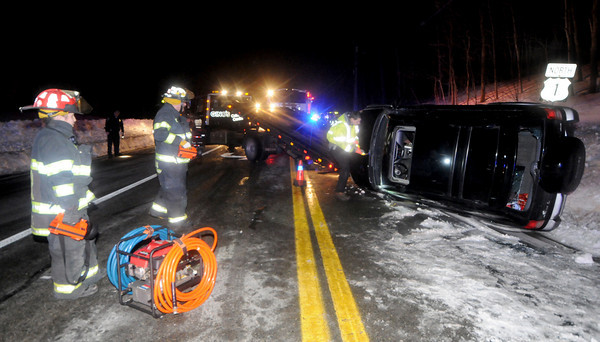 Rowley: Firefighters at the scene of a rollover on Rt 1 in Rowley Friday night. Jim Vaiknoras/Staff photo