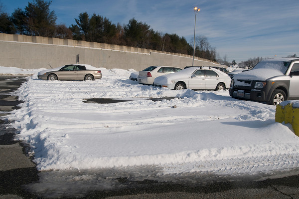 Newburyport: Unplowed parking spaced at the bus station on Story Ave in Newburyport. Jim Vaiknoras/Staff photo