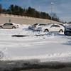 Newburyport: Unplowed parking spaced at the bus station on Story Ave in Newburyport. Jim Vaiknoras/Staff photo