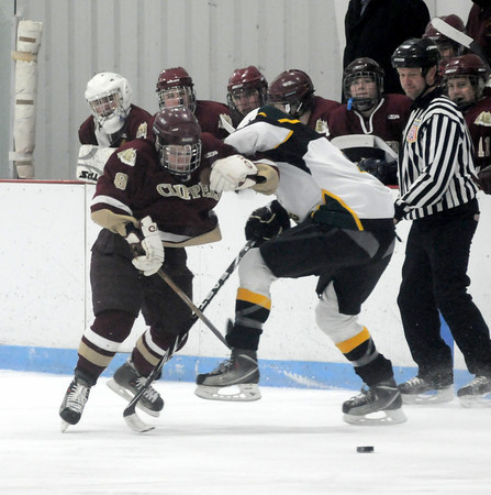 Reading: Newburyportt's Tyler Cussack fights for teh puck with a North Reading player during the Clippers game at the Burbank Rink in Reading Saturday. Jim Vaiknoras/Staff photo