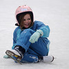 Amesbury: Amelia Karby, 6, laughs after falling down skating at the  outdoor rink at the town park in Amesbury Sunday morning. Jim Vaiknoras/Staff photo