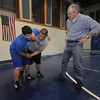 Georgetown: Georgetown wrestling coach Mike Curley works with  Eric Gesualdi<br />  and Mason Dalley during practice at teh Perley School in Georgetown. JIm Vaiknoras/Staff photo