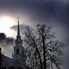 Newburyport: The sun brakes through storm clouds over the Uniterian Church in Newburyport Friday afternoon as the morning snow begin to die down. Jim Vaiknoras/Staff photo