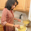 Newburyport: Lygia Soares dishes a rice dish in her Newburyport kitchen. Jim Vaiknoras/Staff photo