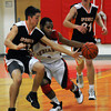 Amesbury: Amesbury's Stephan Deas dribbles under pressure from Ipswich's Louis Galanis during the team's game  at Amesbury Friday night. Jim Vaiknoras/Staff photo