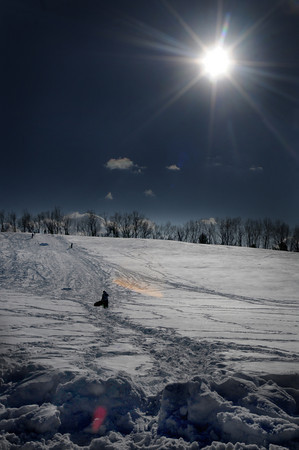 Amesbury:Sledders brave the cold sunday afternoon to make a few runs down the big hill at Woodsom Farm. Jim Vaiknoras/Staff photo