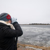 Newburyport: Aisling O'Shea of Somerville watches the skyes over Cahsman Park in Newburyport looking for eagles as part of the annual nationwide Midwinter Bald Eagle Survey. Jim Vaiknoras/Staff photo