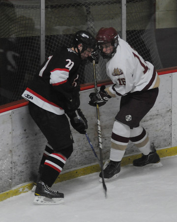 Newburyport: North Andover's Jake Silk fights for the puck with  Newburyport's Dominic Ferreira during their game at the Graf Rink in Newburyport Thursday night. Jim Vaiknoras/Staff photo
