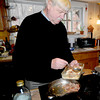 West Newbury:Jim Dougherty spoons sausage as he  prepares in a strata at his West Newbury home. Jim Vaiknoras/Staff photo