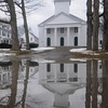 Amesbury: The Main Street Congregational Church in Amesbury is reflected in melting snow on it's walk way. Jim Vaiknoras/Staff photo