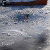 Salisbury: A lone boat at Bridge Marina in Salisbury is surrounded by ice early sunday morning. Jim Vaiknoras/Staff photo