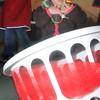 Newburyport:Ania Tymowski, 14 months, gathers juggling balls from a basket  at the 40th anniversary of the Newburyport Montessori School social held at Nicholson hall in Newburyport Saturday afternoon. JIm Vaiknoras/Staff photo