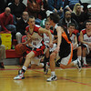 Amesbury: Amesbury's Devlin Gobell drive to the basket during the team's game against Ipswich at Amesbury Friday night. Jim Vaiknoras/Staff photo