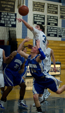 hamilton:  Hamilton-Wenham's Chris Hamilton blocks a Georgetown shot during their game at Hamilton Friday night. Jim Vaiknoras/Staff photo