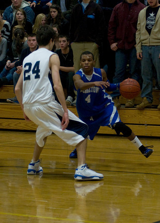 hamilton: Georgetown's John Spears makes a move on Hamilton-Wenham's Colin Kenney, during the Royal's game at Hamilton Friday night. Jim Vaiknoras/Staff photo