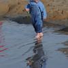 Salisbury: Noah Rhodes, 2, splashes around in the spring like weather at Salisbury Beach Saturday morning. Jim Vaiknoras/Staff photo