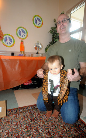 Newburyport:Judah Pilz ,8 months, dresses up in 70's clothes with his dad Mike at the 40th anniversary of the Newburyport Montessori School social held at Nicholson hall in Newburyport Saturday afternoon. JIm Vaiknoras/Staff photo