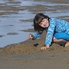 Salisbury: Georgia Wood uses a clam shell to dig in the wet sand on a unseasonably warm New Years Day on Salisbury Beach. Jim Vaiknoras/Staff photo