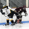 Reading: Newburyport's Adam McElroy knocks the puck away from a North Reading player during the Clippers game at the Burbank Rink in Reading Saturday. Jim Vaiknoras/Staff photo