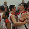 Amesbury: Tyler Lay is congradulated by his teammates after a monsterous dunk during the Indian's game at home against Ipswich. Jim Vaiknoras/Staff photo