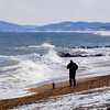 Newbury: Marty Conolly takes a cold walk on a sunny Plum Island Beach Saturday afternoon. Jim Vaiknoras/Staff photo
