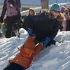 Newburyport: Pat Batten, of Newburyport, pulls her sone Jack 5, up one of the hills at the annual Winter Carnival at the Battlet Mall in Newburyport. Jim Vaiknoras/Staff photo