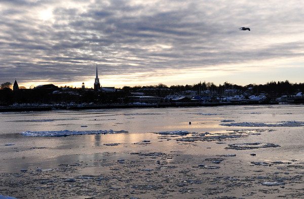 Newburyport: A wintry sky covers downtown Newburyport yesterday as temperatures were expected to dip into single digits overnight. Bryan Eaton/Staff Photo