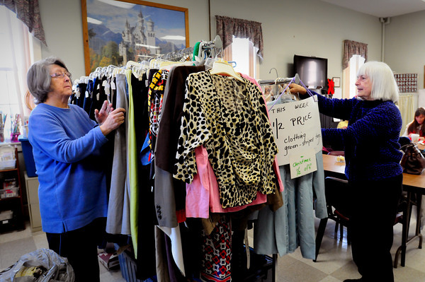 Amesbury: Barbara Donovan, left, takes a break from the knitting club at the Amesbury Council on Aging to check out some items from the thrift shop, as volunteer Jane Morse stocks more donations on Tuesday morning. The shop, which raises funds for some activities, is open Monday through Friday from 8:00am-3:00pm. Bryan Eaton/Staff Photo