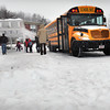 Amesbury: Amesbury Elementary School Principal Walter Helliesen, back to camera, sees students off as school let out there and in the region early due to storm number one. Bryan Eaton/Staff Photo