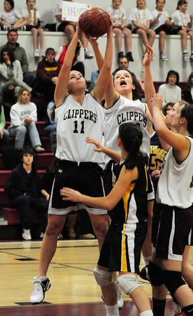 Newburyport: Newburyport basketball player Haley Johnson, left, in recent action against Lynnfield. Bryan Eaton/Staff Photo