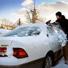 Newburyport: Mike Cenower of Newburyport cleans off his car in the Green Street lot in Newburyport yesterday as the sun breaks out after a fast moving storm left about 6 inches of snow in the area. More snow is forecast for the middle of next week. Bryan Eaton/Staff Photo
