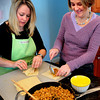 Rowley: Mary Rooney, left, and Amy Treseler prepare eggrolls. Bryan Eaton/Staff Photo
