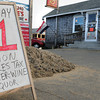 Newbury: A sign outside Mr. Moe's Package store on Plum Island reminds people the sales tax on alcohol is no more. Bryan Eaton/Staff Photo