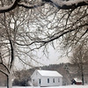 Newbury: The school house on Newbury's Lower Green was framed with snow-laden branches as the snowfall came to an end Wednesday afternoon. Bryan Eaton/Staff Photo