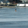 Amesbury: An ice fisherman has Lake Gardner in Amesbury to himself as he drilled holes there on Thursday morning. Bryan Eaton/Staff Photo