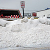 Salisbury: Christy's and Tripoli Pizza at Salisbury Beach are almost always open in all kinds of weather, but their buildings are almost out of view from the opposite side of Broadway due to the piles of snow. Bryan Eaton/Staff Photo