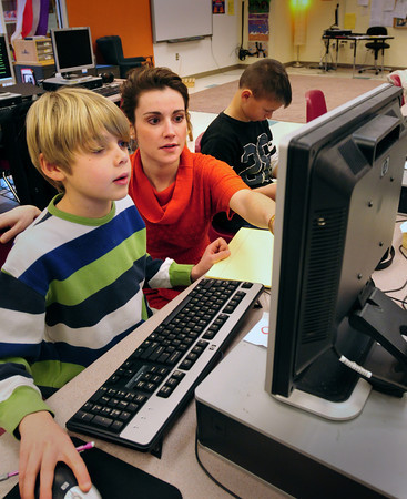 Newbury: Michelle Twombly, the new talented and gifted specialist for the Triton School district works with Quentin Callewaert, left, and Aiden Goujon, both 10, at Newbury Elementary School. Bryan Eaton/Staff Photo