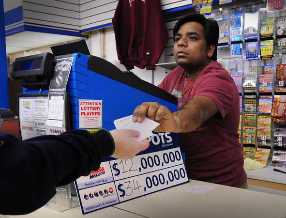 Salisbury: Chris Patel of Gulf Express in Salisbury Square sells a Powerball ticket with the jackpot worth $34 million.  The gas station and convenience store sold a second place Mega Millions ticket worth $250,000 in Tuesday's drawing. Bryan Eaton/Staff Photo