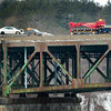 Newburyport: A white Toyota sits on a flatbed after a crane, right, pulled it from the Merrimack RIver Tuesday morning on the Whittier Bridge after the driver flipped over the guardrail on Monday night. The body of the lone occupant, Charles Moncousky of North Hampton, N.H. was pulled from the vehicle about three hours after the accident. Bryan Eaton/Staff Photo