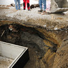 Newburyport: What's believed to have been the bulkhead of Bartlet's Wharf at the lower end of Lime Street and now in the Newburyport Water Treatment Plant has been unearthed. Looking at the timbers below are, from left, Tom Kolterjahn, Bill Harris and Tim Barker, and archaeologist with University of Massachusetts. Bryan Eaton/Staff Photo