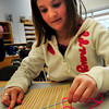 Salisbury: Sheridyn LaRocque, 9, learns the basics of weaving as she makes a wall hanging in Amy Merluzzi's art class at Salisbury Elementary School on Tuesday. Bryan Eaton/Staff Photo