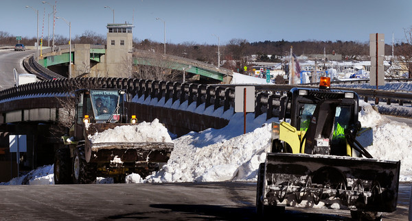 Newburyport: A state highway crew moves snow in anticipation of the next two storms along Winter Street in Newburyport at the onramp to Route One yesterday morning. Bryan Eaton/Staff Photo